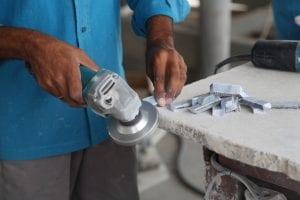Dry cutting and polishing kitchen benchtops generates hazardous dust